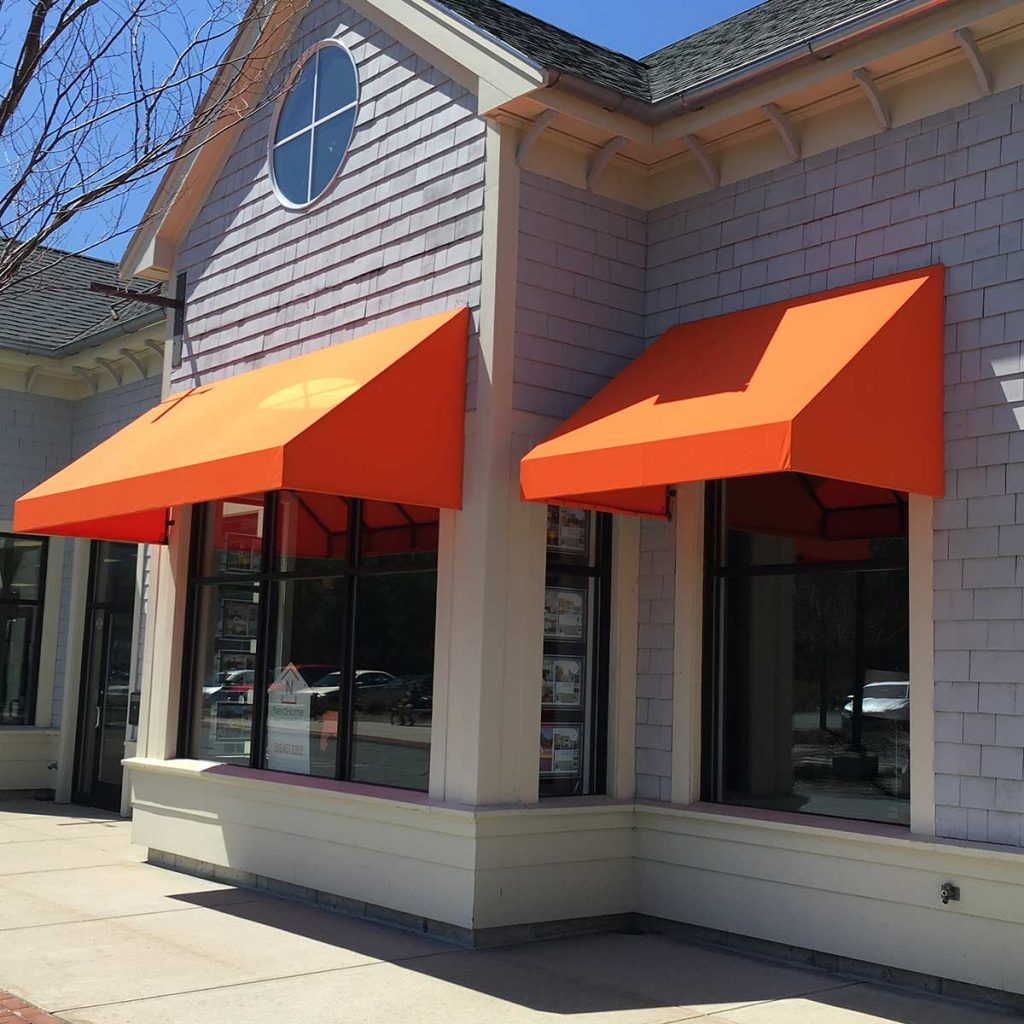 Custom storefront awnings add beautiful shade and curb appeal to any business!